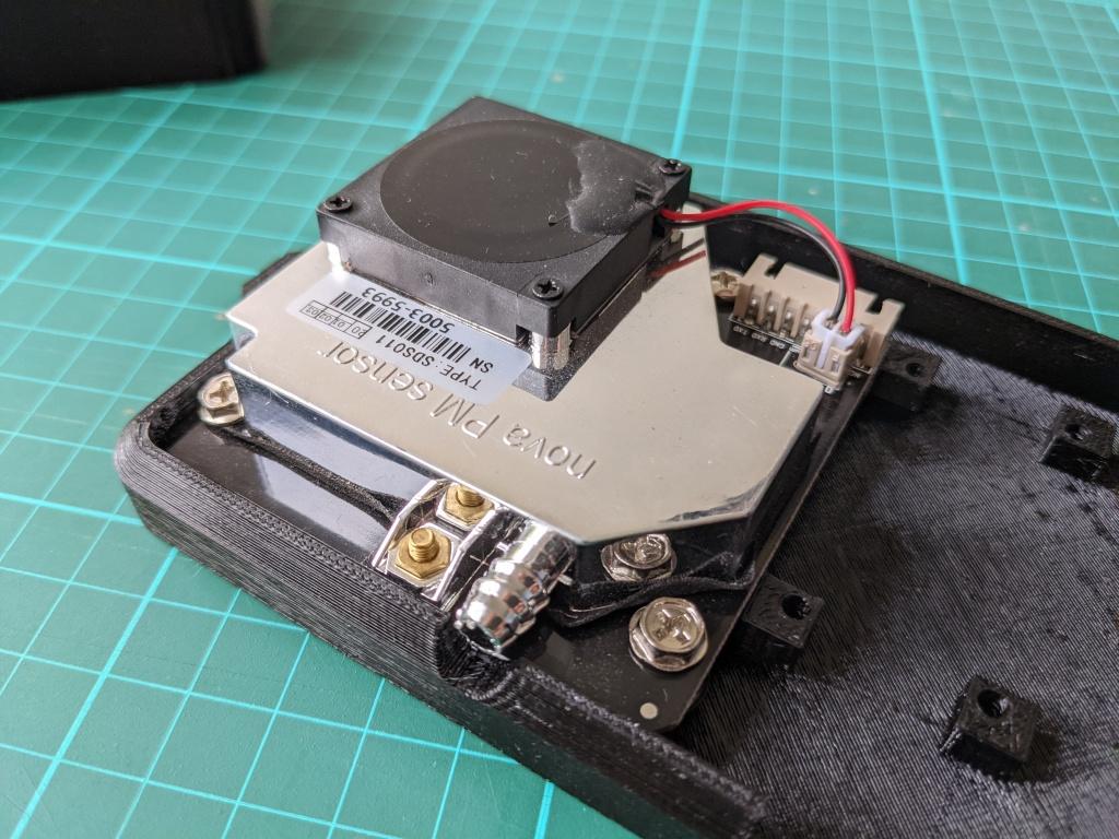Photo of sensor screwed into case.